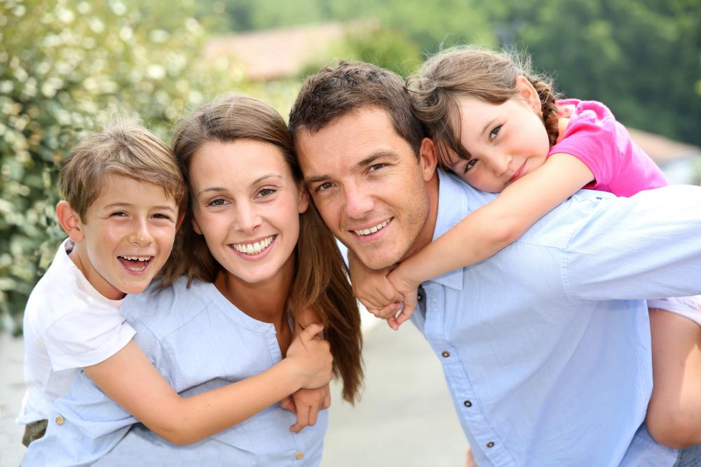Family smiling about the family wellness services that their chiropractor provides.