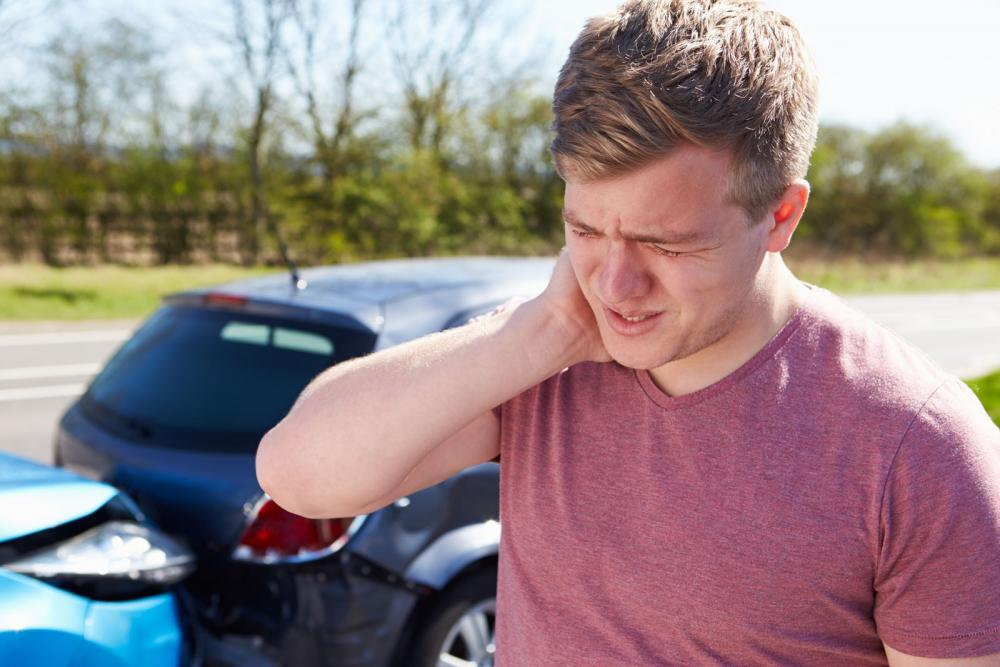 man having neck pain from auto accident