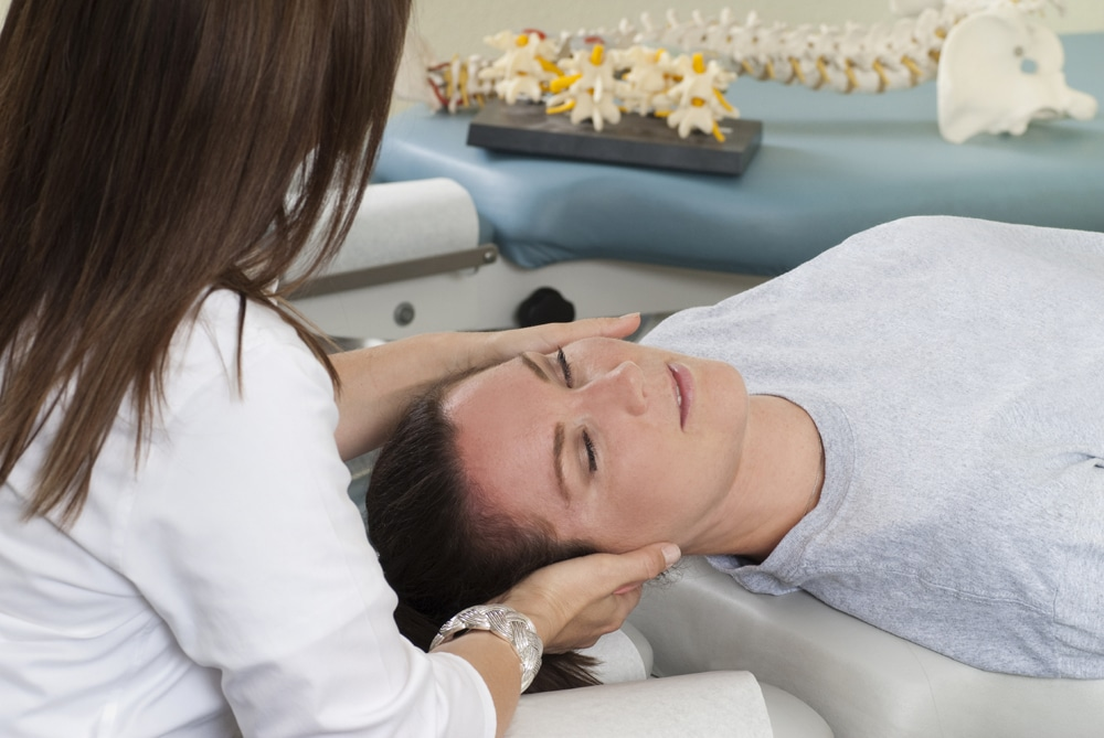 female patient getting neck pain treatment