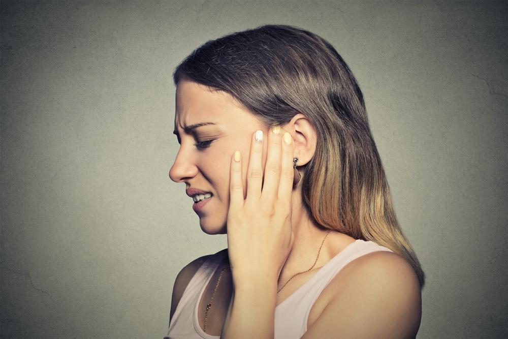 Woman with a headache in Columbus